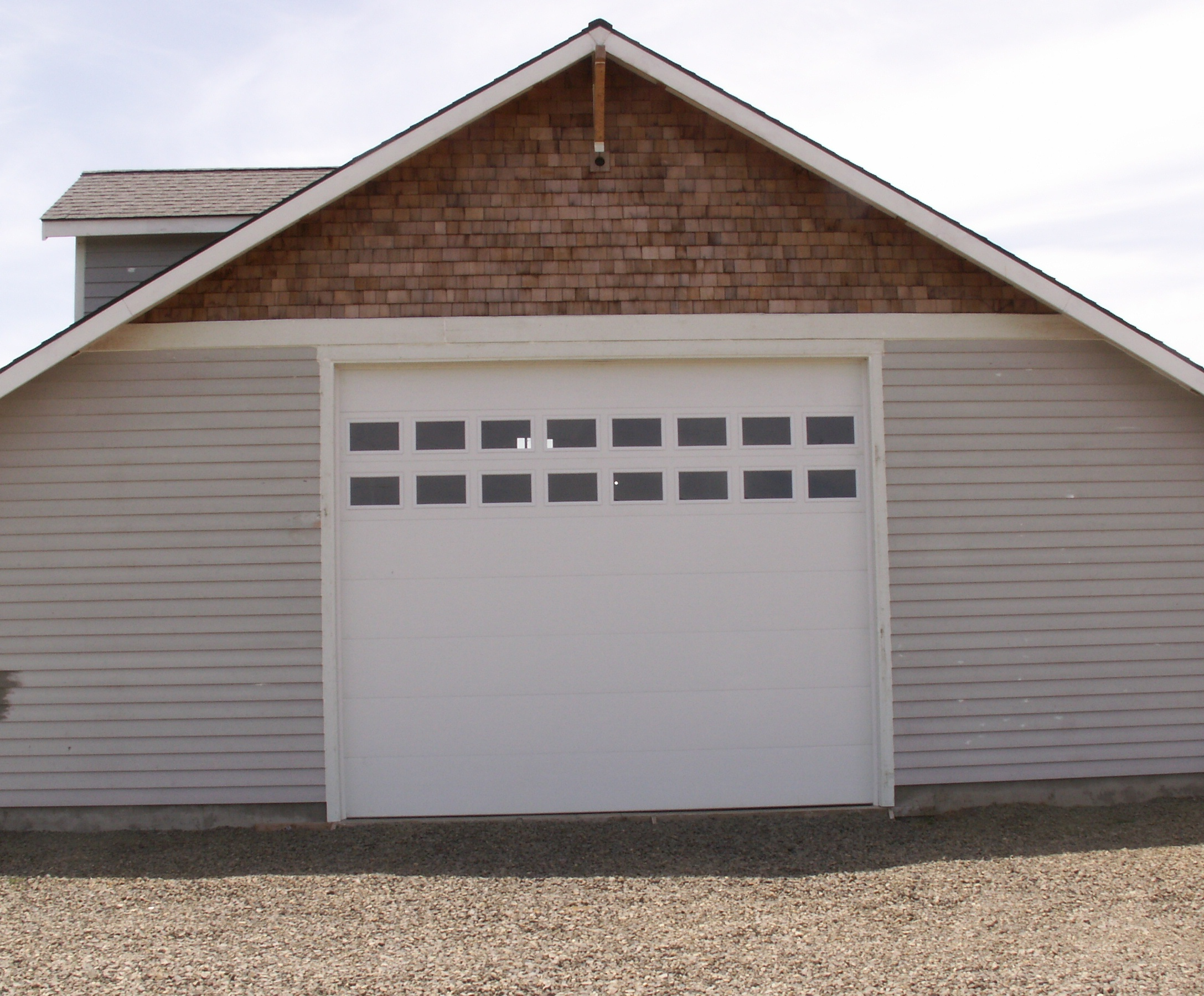 arched grove steel door panel city garage windows installed pin with doors whitby carriage insulated these clopay short